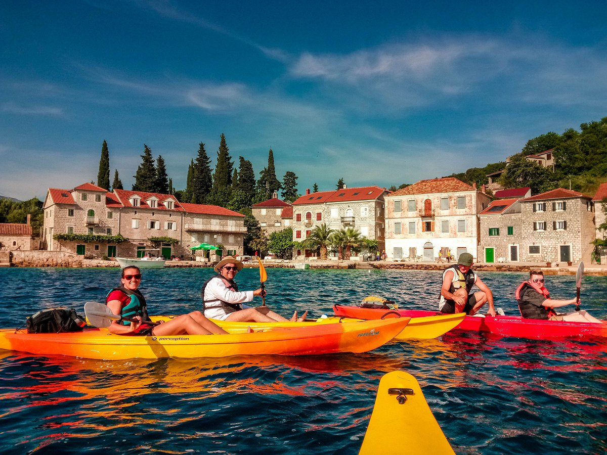 kayaks with Rose village in the background